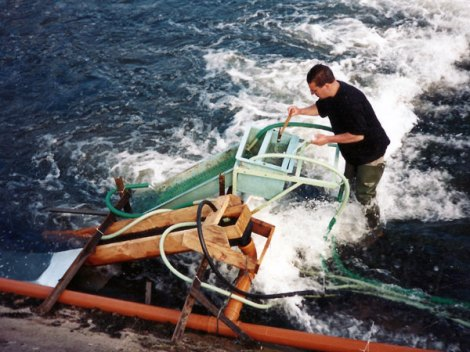 Patrick Real working on the River Maigue traps, June 1997. Dr. William O'Connor and Patrick Real captured over 0.5 million glass eels during the week following this picture. This work was not completed by Inland Fisheries Ireland.